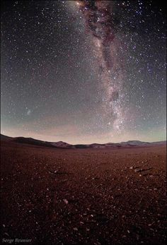 Southern Milky Way above Mars-like red sands of Atacama Desert. The location is…