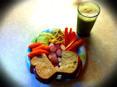 Lunch Sandwich - sliced tomato, sliced red onion, balsamic vinaigrette, salt, pepper on 12 Grain bread.  Sliced radish, cucumber, red pepper, baby carrots with roasted garlic & roasted red pepper humus dip.   and 8oz of vanilla soy Silk