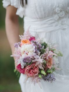 Boho Woodland bridal bouquet of Vuvuzela Roses, Peonies, Astilbie, Lilac  designed and created by Hannah Berry Flowers based in Farnham Surrey www.hannahberryflowers.co.uk Photo take by http://stephanieswannweddings.co.uk Dress from http://hannahelizabethbridal.com