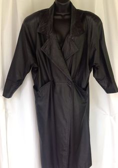 Stay warm AND keep up with the retro 1980s trend with this Winlit black leather coat! Can you say #ShoulderPads ?? Women's size Medium.