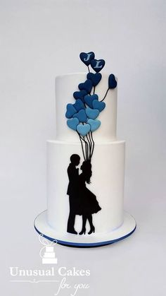 Silhouette couple with ombré heart balloons