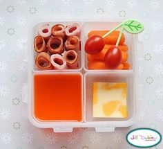 This was a bento box for her afternoon nutrition break. She got a container of lunch meat roll-ups (turkey and ham), a container of baby carrots with cherry tomatoes on a leaf pick, a container of orange jello and some slices of marble cheese.