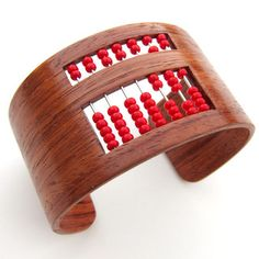 The Abacus Bracelet. Beautiful and a little nerdy- I wish I had the patience to actually make this!