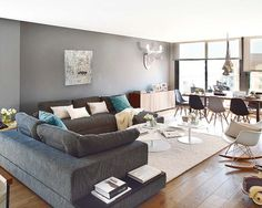 gray sofa and gray walls with turquoise and cream accents