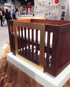 The Halo Crib from @nurseryworks features a 24K gold plated aluminum embellishment and converts to a toddler bed—definitely a glamorous statement. {From #abckids14}