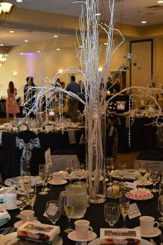 Gorgeous silver centerpieces at Crystal and Will's May wedding. #weddingideas #capriottiscatering #centerpieces