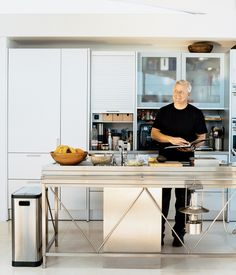 "In John Picard's home in Manhattan Beach, the aluminum Bulthaup System 20 kitchen with its nine-foot-long stainless steel island has become a focal point of the house. Pressed in one seamless sheet of steel, the island, Picard says with the obvious pride of a satisfied customer, ""is an amazing piece of engineering."" Photo by Gregg Segal"