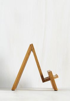 Easel Does It Tablet Stand. Flaunting the perfect fusion of classic and modern, this charming wooden tablet easel proves that theres no school like old school. #multi #modcloth