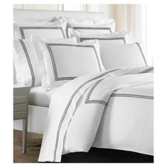 Add a hint of elegance to the bedroom with our Strada Bedding Collection. Each of the collections' crisp white linens is crafted from 60% Long Staple Cotton, and 40% Tencel for luxurious softness and durability. The Strada Collection is 300 thread count Percale and features three embroidered lines along the entire border of the Duvet. The Duvet features a hidden button closure back.