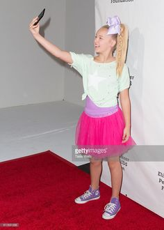 Dancer JoJo Siwa takes a selfie on the red carpet at Elizabeth Glaser... News Photo | Getty Images