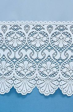 Elmham is a finely woven voile with a heavy lace border. The elaborate lace is balanced by the plain voile.
