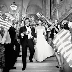 "Brides Magazine:      THE MOMENT  WEDNESDAY JULY 4, 2012        Photo: Corinna Raznikov  ""Since we got married on the Fourth of July, we thought having our guests wave flags would be a fun alternative to a sparkler send-off... The band even played 'God Bless America.' It made for a really great—and emotional—departure.""—Elizabeth, on the festive send-off at her Fourth of July wedding."