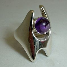 Vintage Georg Jensen Ring #139, Sterling silver with Amethyst, designed by Henning Koppel $450.00 Condition: fine vintage, preowned Year: after 1945 Size: 7 1/2, can be sized for free.