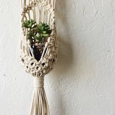 This DIY macrame hanging planter pouch pattern, adapted and updated from vintage, is an invitation to the world of macrame, an ancient yet modern place. With the help of this digital pattern with color photos and illustrated diagrams, you can create a macrame hanging planter pouch
