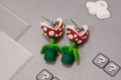 Super awesome accessory for any Mario fan! This Piranha Plant earring set made of polymer clay will sure put a bite in your day! Wear these anywhere and your sure to get a second look! Piranha Plant earrings have the appearance of having quite the grip on the ear. That's a scary thought but don't worry these adorable earrings will cause you no pain, maybe tears of joy though!!
