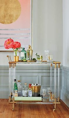 The refractive Lucite and gleaming cast brass of this bar cart are meant to catch the light, drawing all eyes to the clean lines of this Deco-inspired piece by Anthropologie.