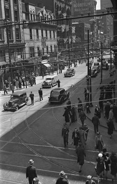 Looking south on Yonge from Queen Street. This May 1939 photo shows the city decorated for the visit of King George VI. [Notice the streetcar tracks on Yonge St.]