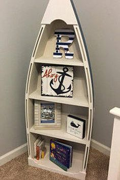 This 5 foot blue row Bookshelf Bookcase shelves skiff schooner canoe nautical Dorey kids room wooden boat shelf Beach decor Photo propp Nursery is just one of the custom, handmade pieces you'll find in our benches & toy boxes shops. Boat Bookcase, Bookshelves Kids, Bookcase Shelves, Book Shelves, Boys Room Decor, Boy Room, Kids Room, Nautical Baby Nursery, Nautical Room Decor