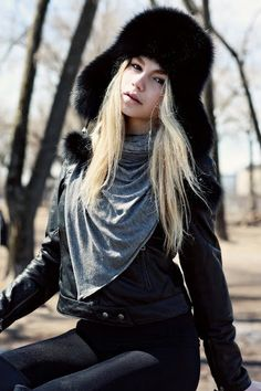 All black!  A popular Russian style winter hat known as the Ushanka.  The fox fur originates from Norway and has been died black. The remaining material is real black leather and stretch from the top of the hat to the ear flaps.