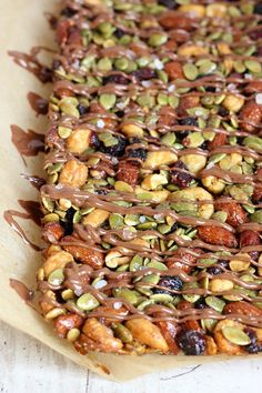 Sweet and salty chocolate drizzled healthy nut bars made with few ingredients and a whole lot of nutrition! Candy Recipes, Sweet Recipes, Snack Recipes, Cooking Recipes, Healthy Cooking, Healthy Snacks, Nutty Bars, Fruit And Nut Bars, Crack Crackers