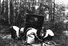Florida Memory - Automobile stuck in the mud. These travelers struggle to free their car from the mud along a wooded stretch of early Florida roadway (circa 1924).