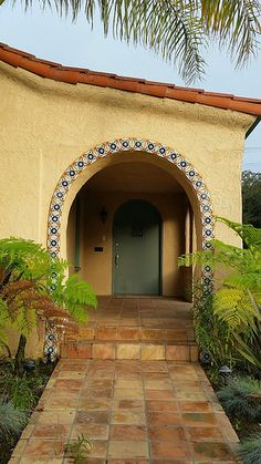 Rustic Saltillo Tile combined with the arch framed with decorative ceramic tiles...perfect!   Avente Tile