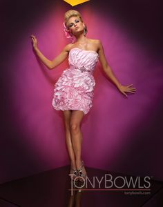 Strapless organza, tulle and charmeuse short sheath with asymmetrical ruffled trim on bodice and skirt, jewel accented charmeuse waistband, flower accented hem. Detachable straps included.