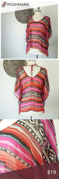 FV21 Baja Semi Sheer Poncho Top FV21 Baja Semi Sheer Poncho Top -BRAND- Forever21 -CONDITION- Perfect -COLOR- REd, black, white, pink, tuquoise -COMPOSITION- Polyester -SIZE- Small- very roomy -MEASUREMENTS- 26in L, 13in sleeve, 42in chest -DETAILS- Vneck , tie back, baja print Forever 21 Tops