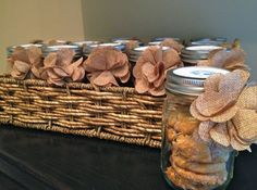 Chocolate chip cookie favors in a mason jar with a burlap flower. A perfect take-a-way for your party guest! #lilymeringue catering Los Angeles.