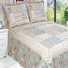 Country Cottage Floral Patchwork Pattern Microfiber Quilt Coverlet and Shams Set.  Oversized quilt to fit extra deep mattress.  Bedding set is reversible to a coordinating pattern for two look in one.  Easy care microfiber fabric.