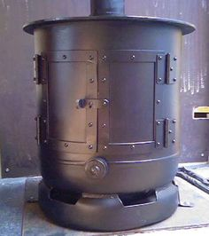Rocket mass heater specifications zaug stove rocket for Whole house wood furnace