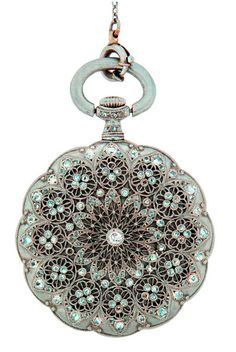 Platinum and Diamond Pendant Watch with Platinum and Pearl Chain, Gorgeous platinum pendant watch with amazing very fine filigree work and encrusted with old mine and rose cut diamonds. Switzerland circa 1910.