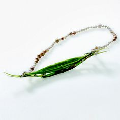 """DOROTHEA DAHNICK-NL: necklace """"pods""""  """"""""swinging floral necklace """" reminds one of blooming fruit on a bush and """"pods necklace"""" is  inspired of pods filled with young peas. """""""