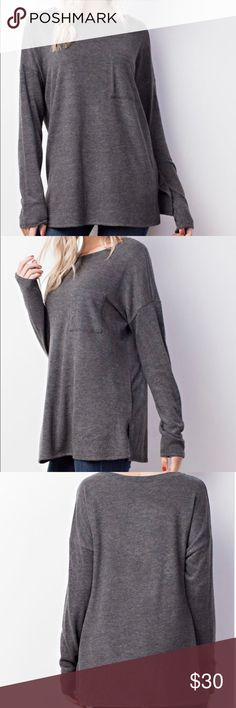 Charcoal fleece front pocketed knit top Charcoal color fleece front pocketed knit top.  This top is so soft and comfy.  64% polyester  33% cotton 3% spandex MTS Tops Tunics