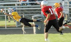 West team wide receiver  Chase Cook of Liberty-Benton dives to pull in a 32-yard, third-quarter scoring pass from quarterback Seth Schmenk o...