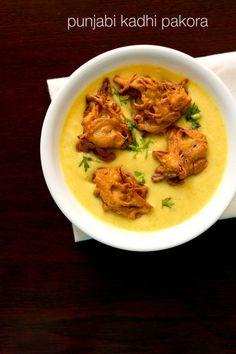 punjabi kadhi pakora - popular north indian recipe of fried onion pakoras in a creamy & sour yogurt sauce.