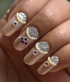 Magnificent Bridal Nail Art Design Idea With Beige Mixed Silver Glitter Nail Polish Combined With Gold And Blue Beads Decoration