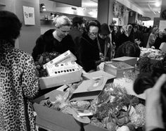 Women move in on merchandise at the sale counter at Lord & Taylor.