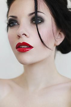 By Bri Wolz. Love the glossy red lips and smokey eye. Normally i would prefer one or the other, but with the dark hair i really like this! Photo by Anastasia Talaiko.To create this look for yourself, start by using your regular face makeup routine then move to your blush.  I suggest the Stila Convertible Color for this look blending with circular motions.  For the eyes you'll apply a base shade with the lightest color in the Cargo Palette then move to the medium brown shade applying in the…