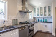 Transitional Kitchen with Flush, High ceiling, Toluca Sand, Quartz, Undermount sink, L-shaped, Hardwood floors, Glass panel