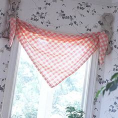 Tablecloth Valances... Tablecloths from the 1940s and 1950s make cheerful valances. Look for bargain linens at garage sails, junk shops, and farm auctions for $5 to $35. Even damaged or stained cloths will work if you can cut them and salvage the good portion. To hang the topper, simply loop the ends through holes in drapery brackets. These are architectural salvage, but you'll find new ones in the drapery departments of sewing and crafts stores.
