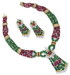 Gem-Set and Diamond Necklace and Pair of Matching Earrings. The necklace composed of ruby and emerald beads, spaced by diamond-set rondelles, connected by spacers set with brilliant-cut yellow diamonds, baguette diamonds and step-cut rubies, the centre highlighted by a cabochon ruby surrounded by variously-shaped diamonds and yellow diamonds, suspending a tassel; and pair of earrings en suite. Sotheby's