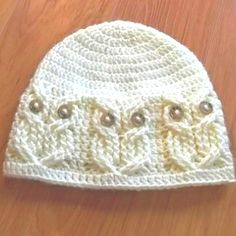 * Hoot-an-owl Hat -- on ravelry Yarns suggested: Caron Simply Soft Solids  Yarn weight: Aran / 10 ply (8 wpi)   Gauge: 14 stitches and 8 rows = 4 inches  Hook size: 5.0 mm (H)