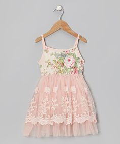 This Aussie-designed dress has a layer of embroidered tulle covering its soft knit lining. Daydreamy and made to slip on, it captures a little girl's idea of upscale style without skimping on comfort.Cotton / polyester / spandexMachine washImported