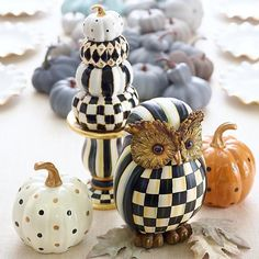 Stacking Pumpkins - Black & White: Pile on the pretty with our Black & White Stacking Pumpkins. Standing tall, this quartet of seasonal favorites is full of polka dots, stripes, and checks that will look gorgeous on top of a sideboard, in your entryway, or running down the center of the table with flowers and candlesticks.