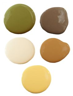 We would use the creamy white as the primary wall color (a good base if you like to switch out your accent colors seasonally!) and use that sunny yellow on an accent wall. Brown would come in through beautiful wood furniture while green and warm yellow-brown make an appearance in textiles like rugs, curtains, and throws.