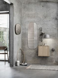 // Muuto Framed mirrors on concrete wall