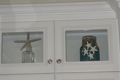 Cute way to fill upper glass front cabinets.
