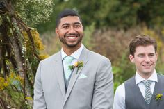 Groom and best man watching the bride. Mint farm wedding ceremony