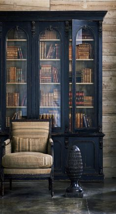 Rustic elegance | upholstered striped armchair | elegant dark blue bookcase with glass doors | Ralph Lauren Home